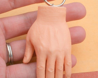 The HUMAN HAND Keychain...plastic charm. space craft. retro. kitsch. i want to believe. urban. hipster. creepy. unique. fingers. hands.