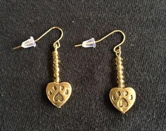 Gold paw earrings