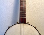 Vintage Ancient Brown and Black 1890s to 1900 mini tenor banjo with buckbee hardware
