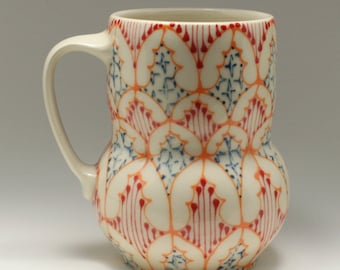Handmade Wheel Thrown Ceramic Mug with Orange, Red and Navy Pattern