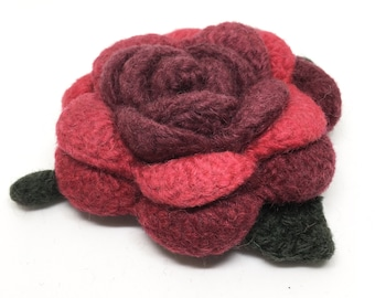 Felted Wool Rose Flower Brooch in shades of Reds with dark green leaves