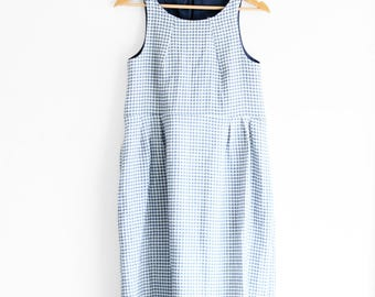 Women's linen checkers dress, midi length. Sleeveless, high neckline, inseam pockets. Made in Italy. Sizes XS to XXL.