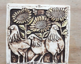 Handmade porcelain tile of chickens and sunflowers
