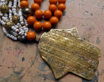 BRASS Moroccan Hamsa With African Goomba Beads; Faceted Carnelian Semi Precious Stones; Ochre Coloured Acrylic Coated & Vintage Brass Beads.