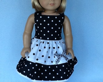 18 inch doll dress and hair clip. Fits American Girl Dolls. Black and white dot ruffled dress.