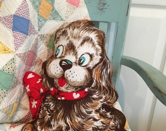 Decorative vintage fabric pillow cocker spaniel with red bow puppy dog