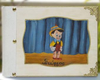 Pinnochio, wood boy, boy scrapbook, disney world, disney scrapbook, memories keepsake, disney figure, parent book, disney album