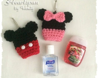 Mickey Mouse or Minnie Mouse Hand Sanitizer Holder with clip to attach to a key chain or bag.  Hand crocheted, fits .5 to 1 oz bottles.
