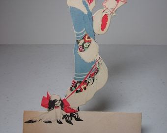 Gorgeous art deco 1920's die cut unused Buzza valentine themed place card flapper wearing deco coat,cloche hat,dog on leash,holds valentine
