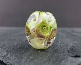 Green and purple swirl lampwork glass focal bead.
