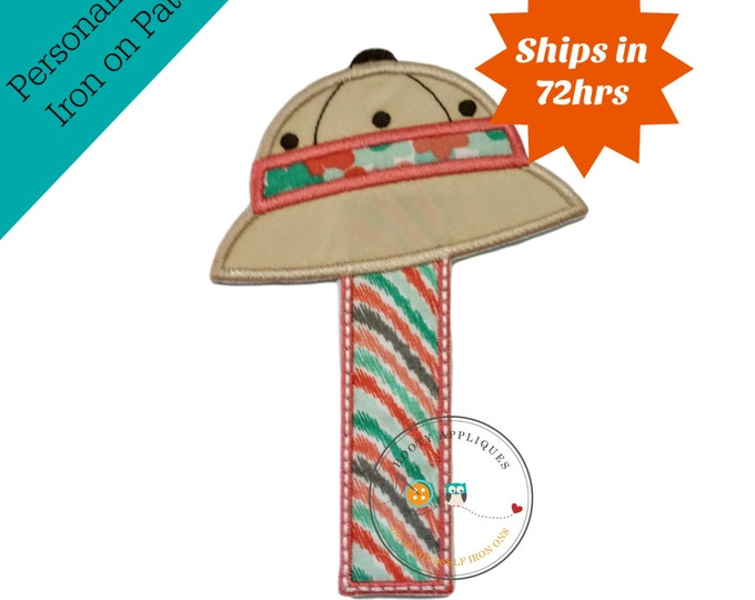 Girl's safari number one in coral, green, gray, and white print embroidered in rich, coral trim. Khaki hat embellished with matching colors.