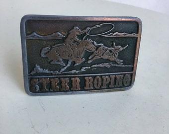 Vintage 1976 belt brass buckle Adezy Co of Steer Roping 3D