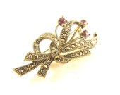 Vintage Brooch Rhinestone Amethyst Glass Floral Spray Marcasite Accents Signed Avon Sweet Pin