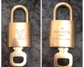80's vintage Louis Vuitton gold tone padlock and key set, 305. Number 311 is also available.