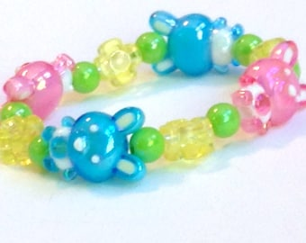 Bunny Friends - Pink and Blue Bunny Stretch Bracelet with Yellow Flowers and Shiny Green Beads