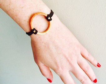 Black suede cord bracelet with walnut wood ring.