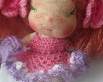 Nella is  a Waldorf doll inspired filled with  millet and lavender and a earth gift box/bed.