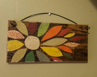 Colorful flower on a pallet board. Rustic. Primitive.