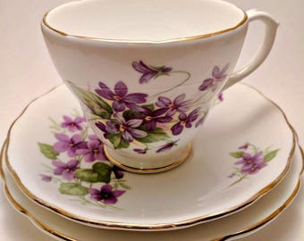 Teacup trio mismatched shades of purple violets - Vintage Duchess teacup, Royal Vale saucer and side plate by Regency - bone English china