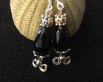 925 sterling silver ear piece.  Black shimmer crystal earrings