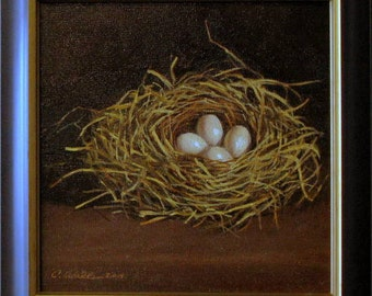 Bird Nest With Four Eggs