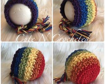 Crocheted rainbow newborn bonnet