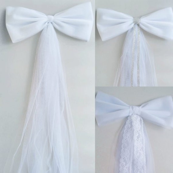 Hand tied wedding pew bows are carefully constructed using the finest ribbon available and are shipped fluffed and ready to go. Simply open the box and your bows are ready to use. Simply open the box and your bows are ready to use.