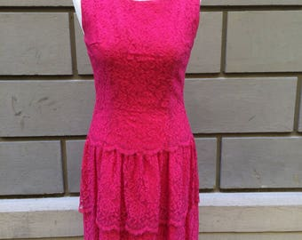 1950s lace dress from a Royal chief supplier.