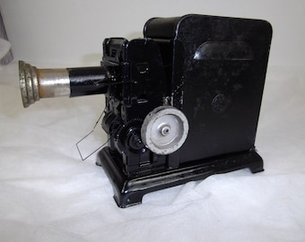 vintage 32mm hand cranked film projector, magic lantern