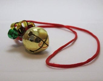 Vintage 1990s Fun Christmas Gold Jingle Bell Necklace with Red Silk Nylon Cord Great Gift and Stocking Stuffer