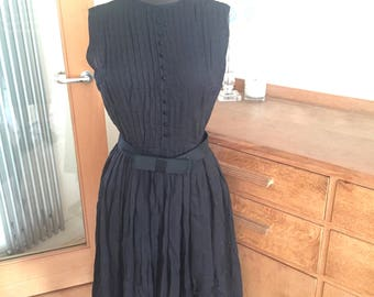 The sweetest little black vintage 50's organdie dress ever invented! Gorgeous detail. Classic Audrey style.