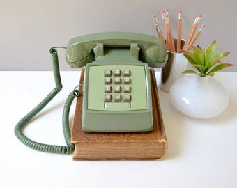 Green push button desk phone; working touch tone telephone; retro telephone; vintage phone