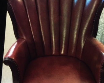 Red leather vintage arm chair