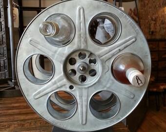 Vintage industrial film reel wine rack