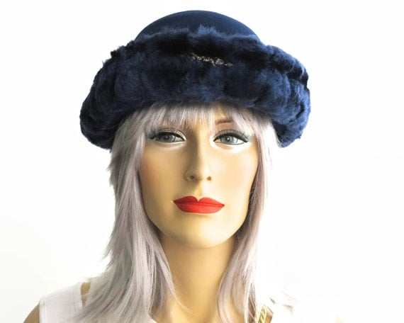 Mid century dark blue hat, wool felt with turned up brim that is covered with matching blue colored faux fur, brim tapers at back, 1960s