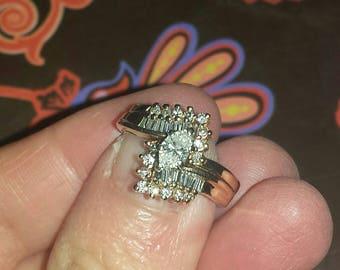 14 Karat yellow gold marquis diamond ring