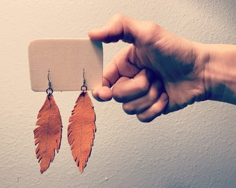Orangish-brown suede feather earrings