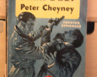 A striking 1950s Pan paperback edition of Peter Cheyney's  classic  story Dark Duet