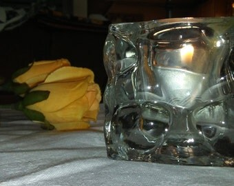Clear glass votive candle holder