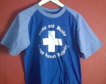 Vintage 90s Tshirt Statement Punks and Skinheads Unite against authority Blue VINTAGE 1990s TSHIRT statement Blue Colorblock S M