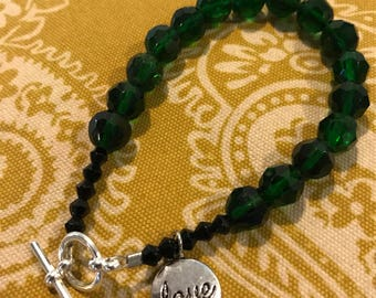 Green beaded bracelet with love charm ALL proceeds benefit French Camp Academy
