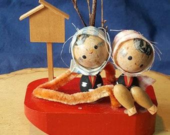 Vintage Kokeshi Doll Couple Sitting on a Geta Shoe