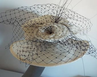 Ladies Dress Hat Ivory and Black  brimmed with rose flower on front and black net around it by Hopkins