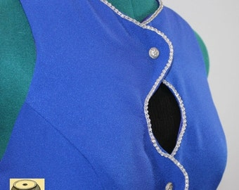 Royal Blue Gown w/ peek-a-boo openings down the front and diamond embellishment. Fully lined. By Alyce Designs
