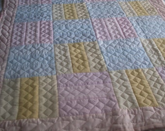 Beautiful hand quilted baby quilt.  This quilt is done in pastel colors that will compliment any nursery.