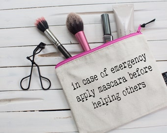 In case of an emergency, apply mascara before helping others. The perfect gift! Quality zipper pouch, hand screen printed to make your day!