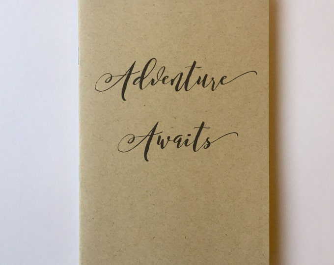 Adventure Awaits Notebook Adventure journal diary premium notebooks typography motivational phrase book pocket notebook logo free