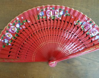 Hand painted wooden fan in red
