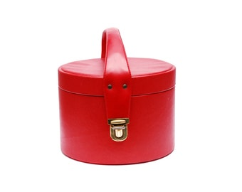 Vintage vanity train case, round cherry red leather imitation cosmetic bag with top handle, golden colored clasp and mirror, 1960s accessory
