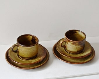 Suisse Langenthal cup, saucer and side plate set of 2. Made of porcelain and with a mottled glaze.